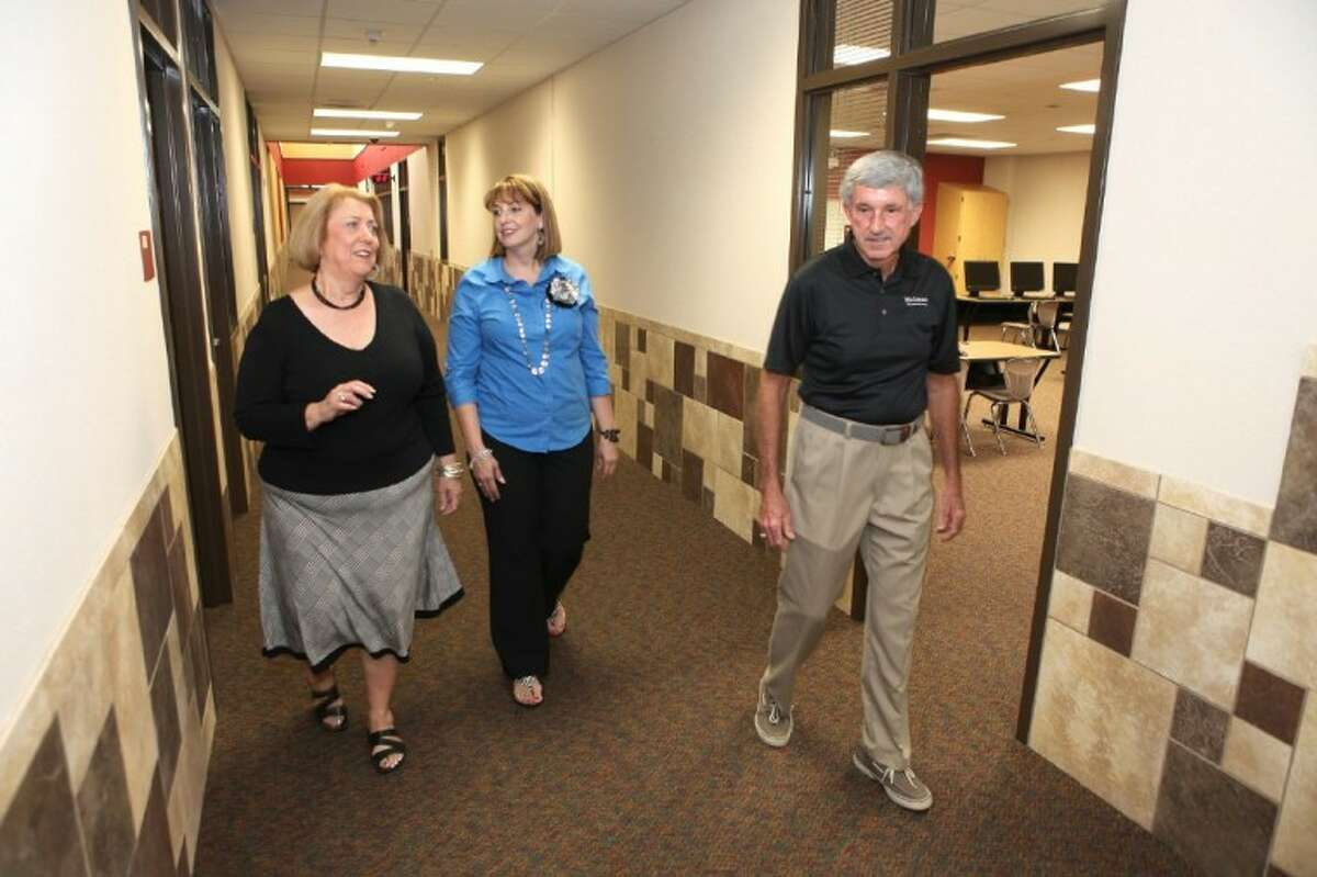 In this 2012 photo, Jamie and Ray Wolman walk down the hallway with Principal Kelly Ricks (middle) inside of Wolman Elementary School, named in their honor in Katy.The school, which opened in 2012, was built for 1,030 students but had an enrollment of 1,683 in fall, 2016.