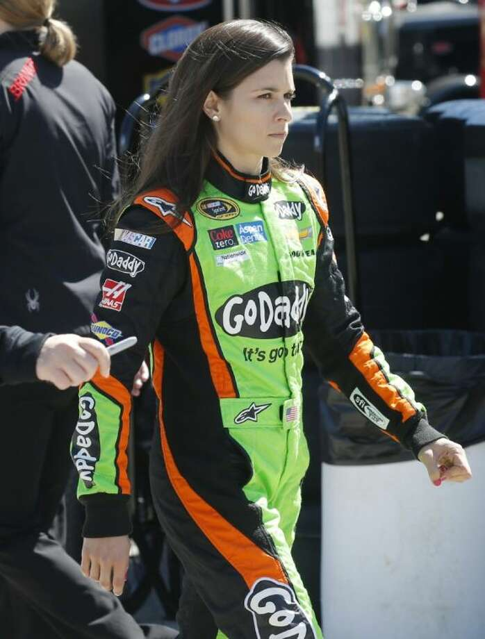 Driver Danica Patrick walks through the garage area before practice begin, Friday, May 9, 2014, at Kansas Speedway in Kansas City, Kan., for Saturday night's NASCAR Sprint Cup series auto race. (AP Photo/Orlin Wagner) Photo: Orlin Wagner