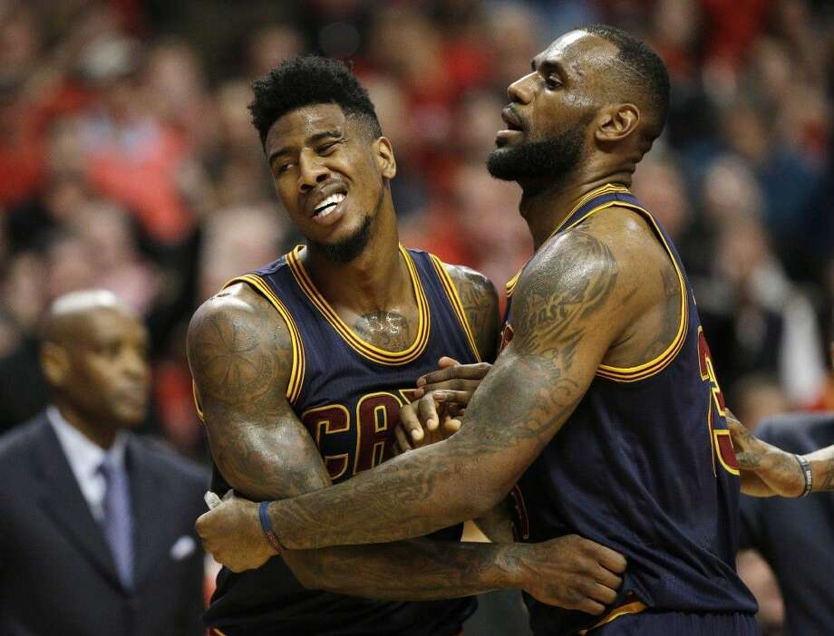 Cleveland Cavaliers guard Iman Shumpert is held by LeBron James against the Chicago Bulls in Chicago on Thursday. Photo: Nam Y. Huh