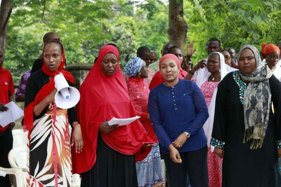 Women attend a rally calling on the Government to rescue the school girls kidnapped from the Chibok Government secondary school, in Abuja, Nigeria, Saturday May 10, 2014. Photo: Sunday Alamba