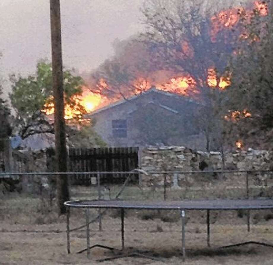 In this May 11, 2014 photo provided by the Texas Department of Public Safety, a wildfire burns near Fritch. The wildfire has led to evacuations and road closures and has destroyed dozens of homes. / @WireImgId=2675712