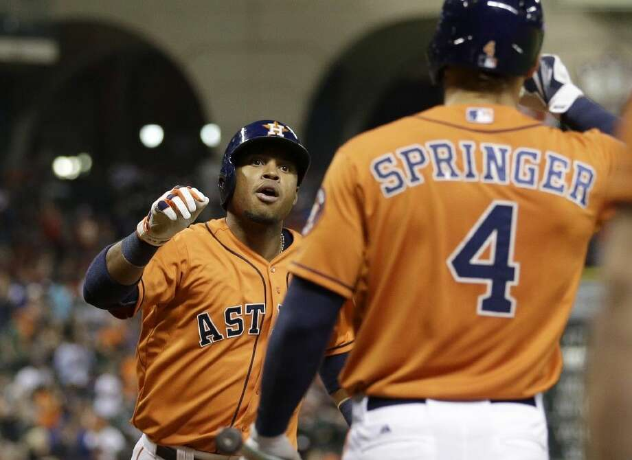 Houston Astros' Luis Valbuena, left, celebrates with George Springer after hitting a home run against the Toronto Blue Jays on Friday in Houston. Photo: David J. Phillip