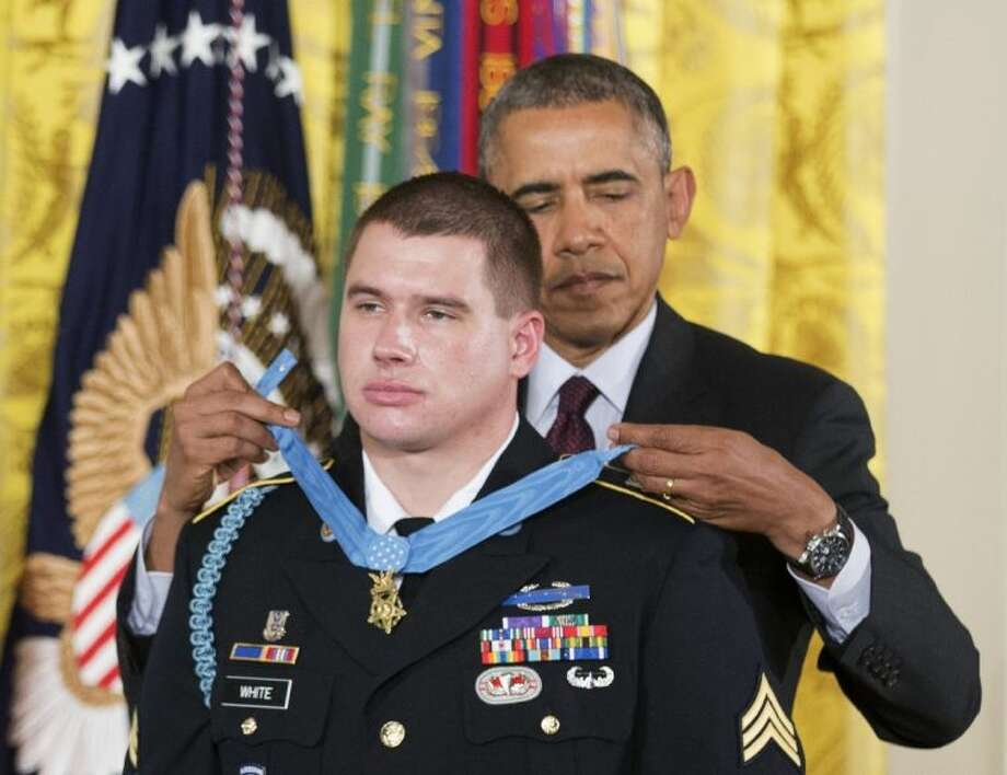 President Barack Obama awards the Medal of Honor to former Army Sgt. Kyle J. White during a ceremony in the East Room of the White House in Washington Tuesday.