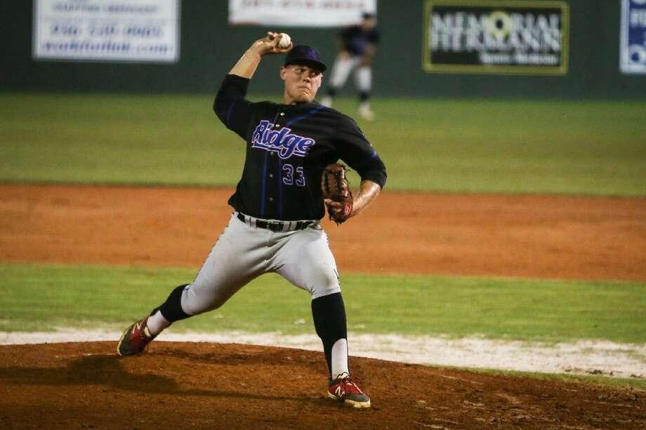 Oak Ridge's Luken Baker throws a pitch against Pflugerville. Photo: Michael Minasi
