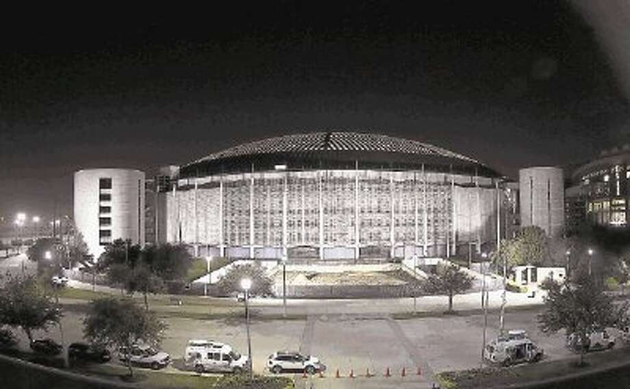 In this Nov. 5, 2013 file photo the Houston Astrodome is illuminated during the evening. / @WireImgId=2675710