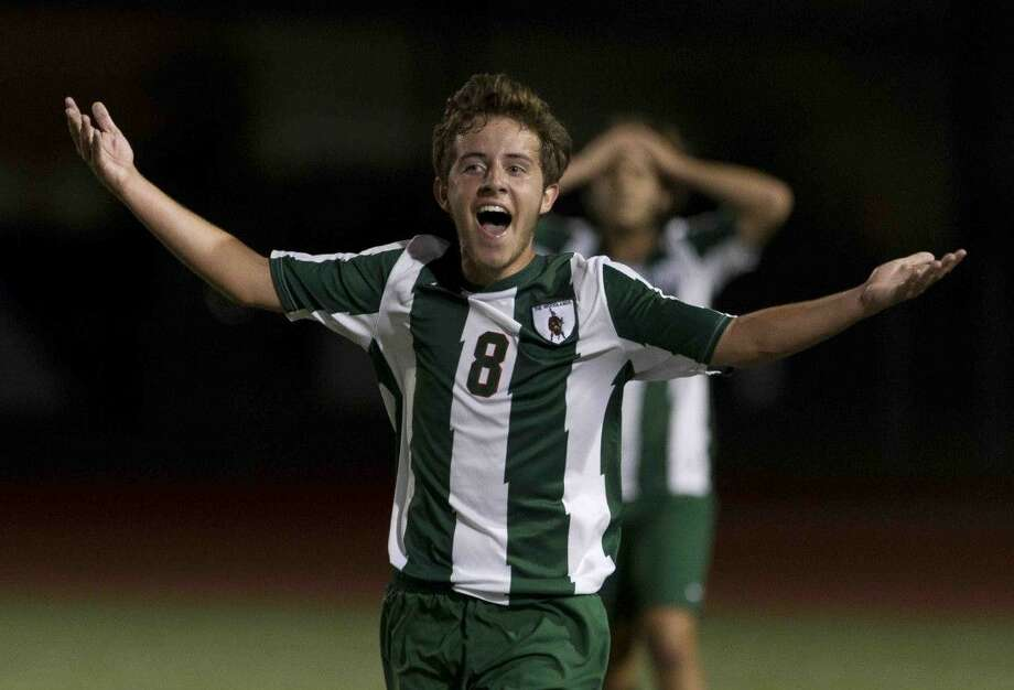 The Woodlands midfielder Julen Ormaza celebrates after the Highlanders defeated Klein Forest 2-1 in a Region II-6A quarterfinal match at Klein Memorial Stadium on Tuesday. Go to HCNpics.com to purchase this photo and others like it. Photo: Jason Fochtman
