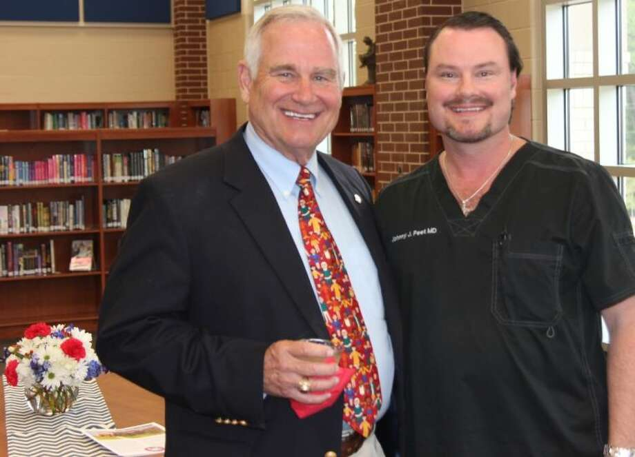 Dr. John V. Peet and his son Johnny Peet pose for a picture during the Open House at Peet Junior High Thursday. The new school building was open to the public and a reception was held.