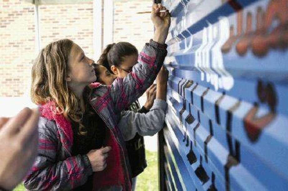 Travis Intermediate sixth-grader Samantha Blackwell works on the school's PODS container art project, which will be displayed at The Woodlands Waterway Arts Festival Friday through Sunday.