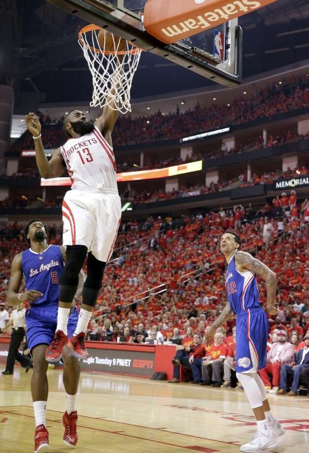 Rockets guard James Harden leaves the Clippers flat footed on a dunk. Photo: David J. Phillip