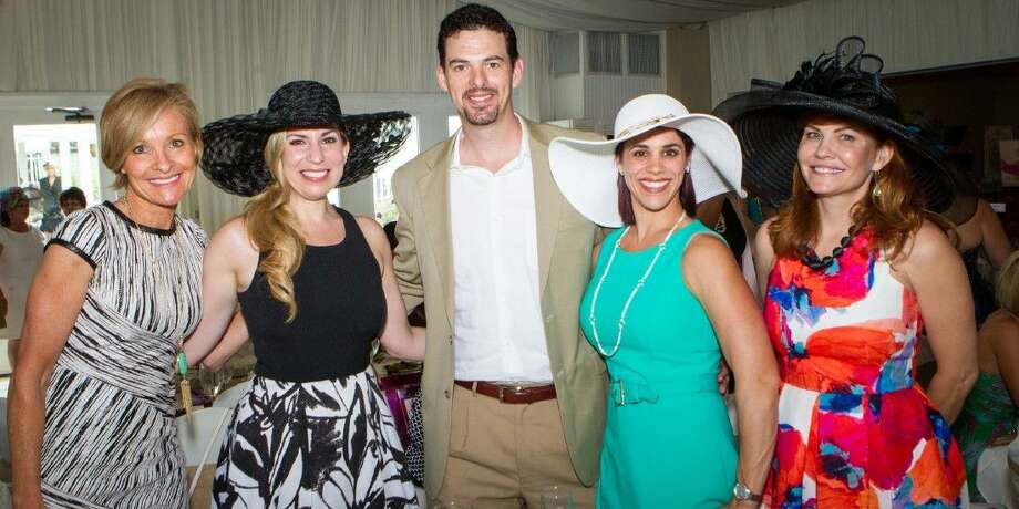 Tea on the Lawn attendees take a photo with Boston Marathon survivor Heather Abbott. Abbott was the event's featured speaker. Pictured, from left, are event emcee Dana Tyson, Abbott, raffle donors John and Dr. Alysia Robichau — Robichau's Jewelry and 2015 honoree Patti Rivela.