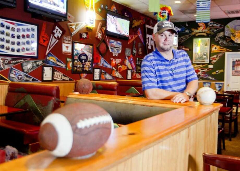 Jeremy Katkoski, owner and operator of Cruisin' J's Hot Wings & Grill in Montgomery. The sports-themed restaurant features burgers, wings and hand-battered chicken tenders, shrimp and chicken fried chicken. Photo: Jason Fochtman