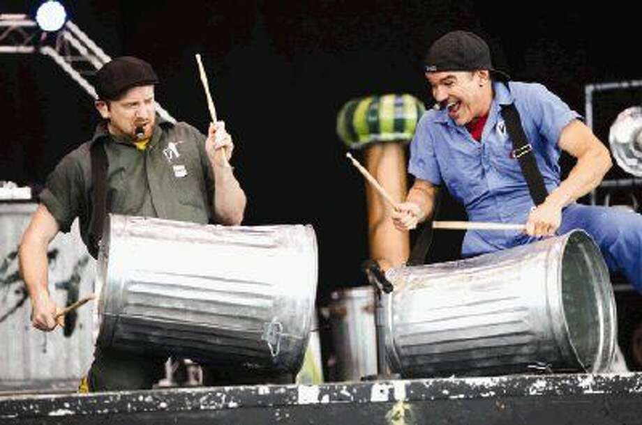Greg Dugan and Steve Linder, of Vocal Trash, drum on trash cans during the Musical Scores event on Monday at the Cynthia Woods Mitchell Pavilion. Photo: Michael Minasi