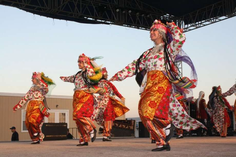 A group of dancers perform on the Azerbaijan stage at the Silk Road Festival outside the Stafford Centre. Organized by the Turquoise Council of Americans and Eurasians from Oct. 4 to 7, the festival gave Houstonians an opportunity to enjoy the food, arts, crafts, dances and music of Central Asia.