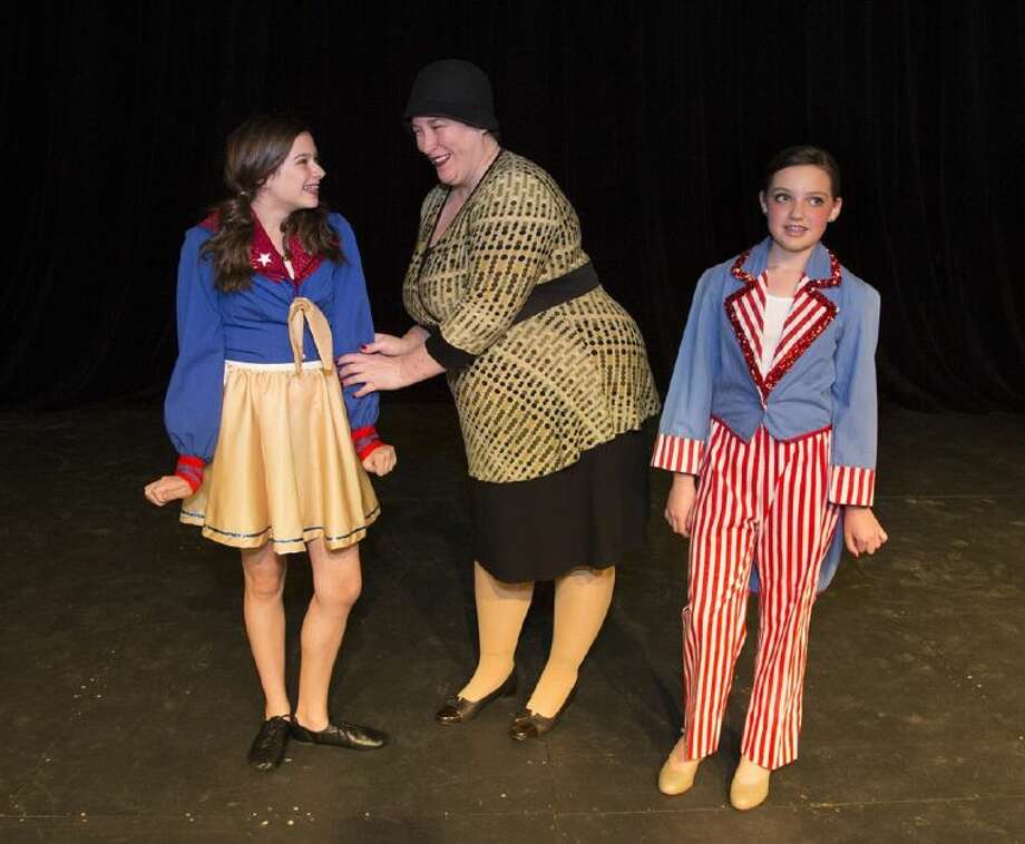 """Mama Rose, center, (Brandi Baldwin) turns her affections to Baby June (Taylor Maresca) while Baby Louise (Bailey Corbin) is left to play a boy's part in """"Gypsy."""""""