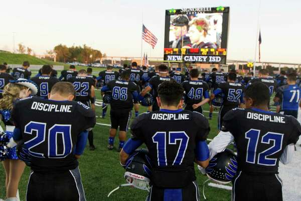 New Caney players pray before the first quarter of a District 21-5A high school football game against Splendora Thursday, Sept. 29, 2016, in Porter.