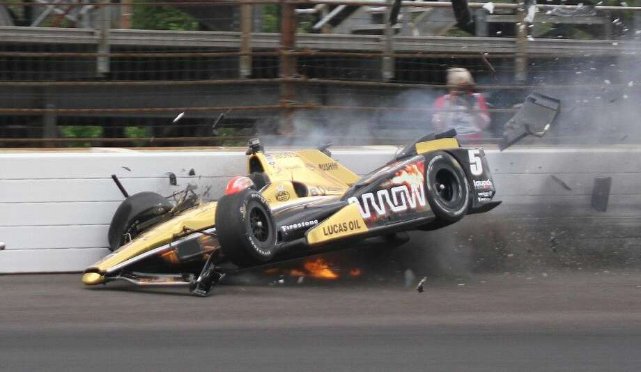 James Hinchcliffe hits the wall in the third turn during practice for the Indianapolis 500. Photo: Jimmy Dawson