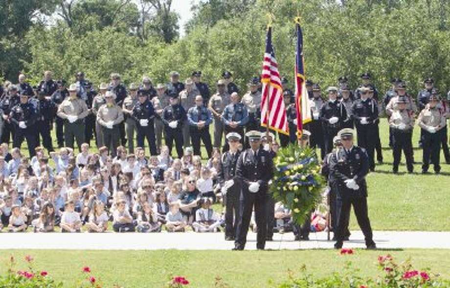Law enforcement officers stand at parade rest during the annual Police Officers Memorial Ceremony at Heritage Place in Conroe Thursday. To view or purchase this photo and others like it, visit HCNpics.com. Photo: Jason Fochtman / Conroe Courier / HCN