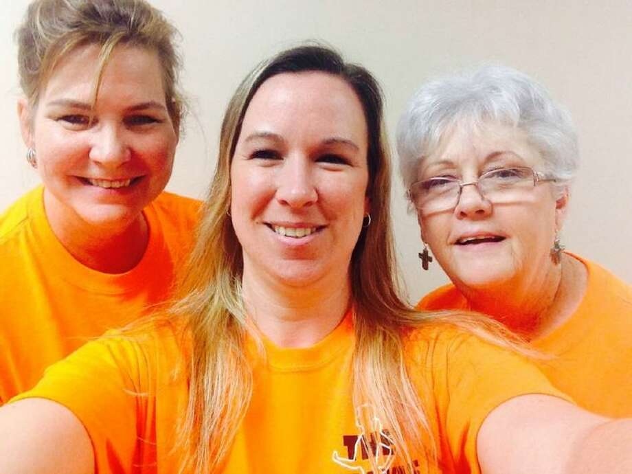 Part of The Walkie Talkies county employee team for Walk Across Texas. Pictured left to right are Doris Golemon, Chief of Staff for County Judge Alan B. Sadler; Lori Stafford, Special Projects Coordinator and Patti Werner, Administrative Assistant II.