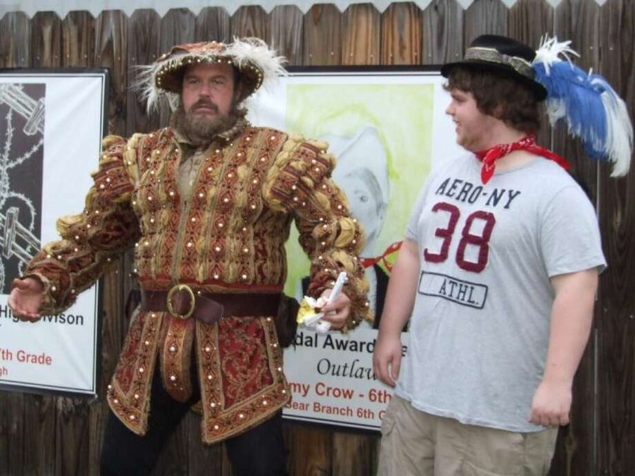 The King of the Renaissance and Jerry Miller, right, converse on who has the best laugh during last year's Stroll Thru the Renaissance in Magnolia. The third annual event will take place Sept. 28 from 4-8 p.m. along The Stroll in Magnolia.