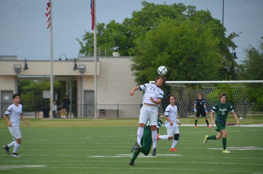 The Woodlands' Nicholas Pekel (26) heads a ball during the UIL Region II-6A semifinal game Friday in Austin.