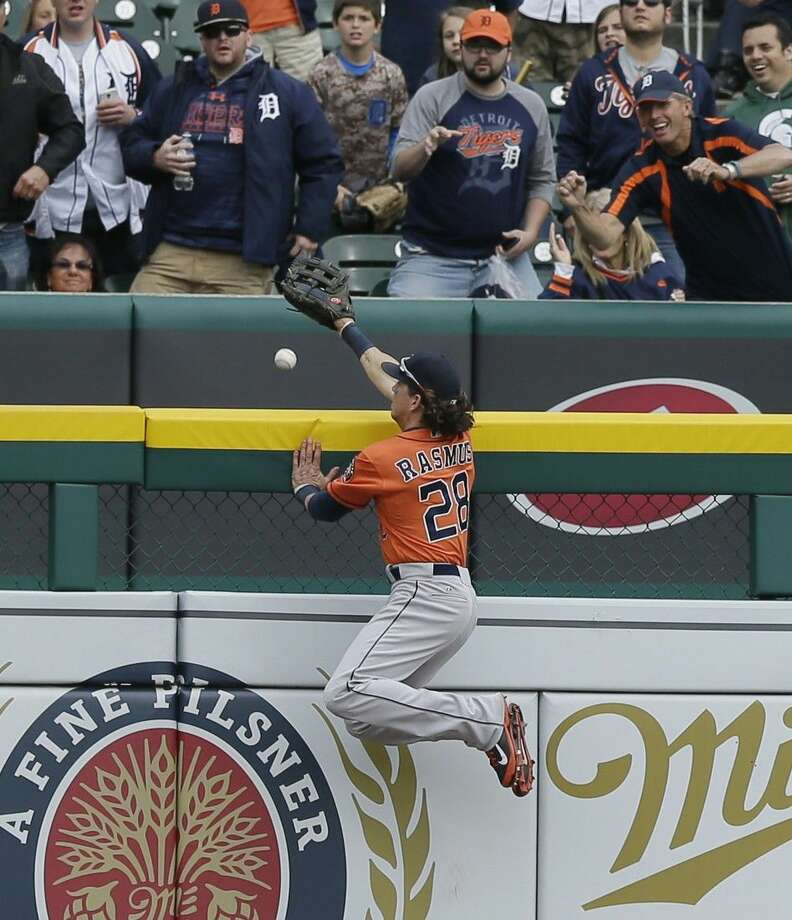 Houston Astros left fielder Colby Rasmus leaps at the wall but is unable to catch the game-winning home run by Detroit Tigers' James McCann during the 11th inning of a baseball game, Thursday in Detroit. Photo: Carlos Osorio