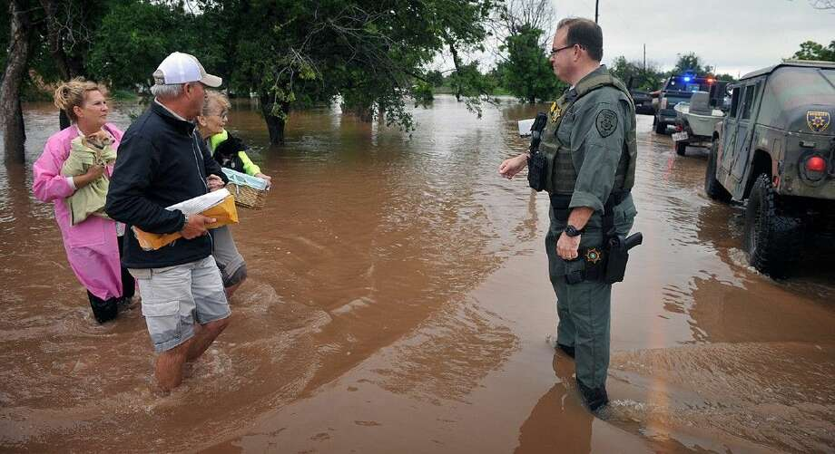 Wichita County Sheriff's deputies assisted an elderly woman after she and her pets were rescued from her home on farm to market road (FM) 367, west of Wichita Falls Wednesday morning. Photo: Torin Halsey
