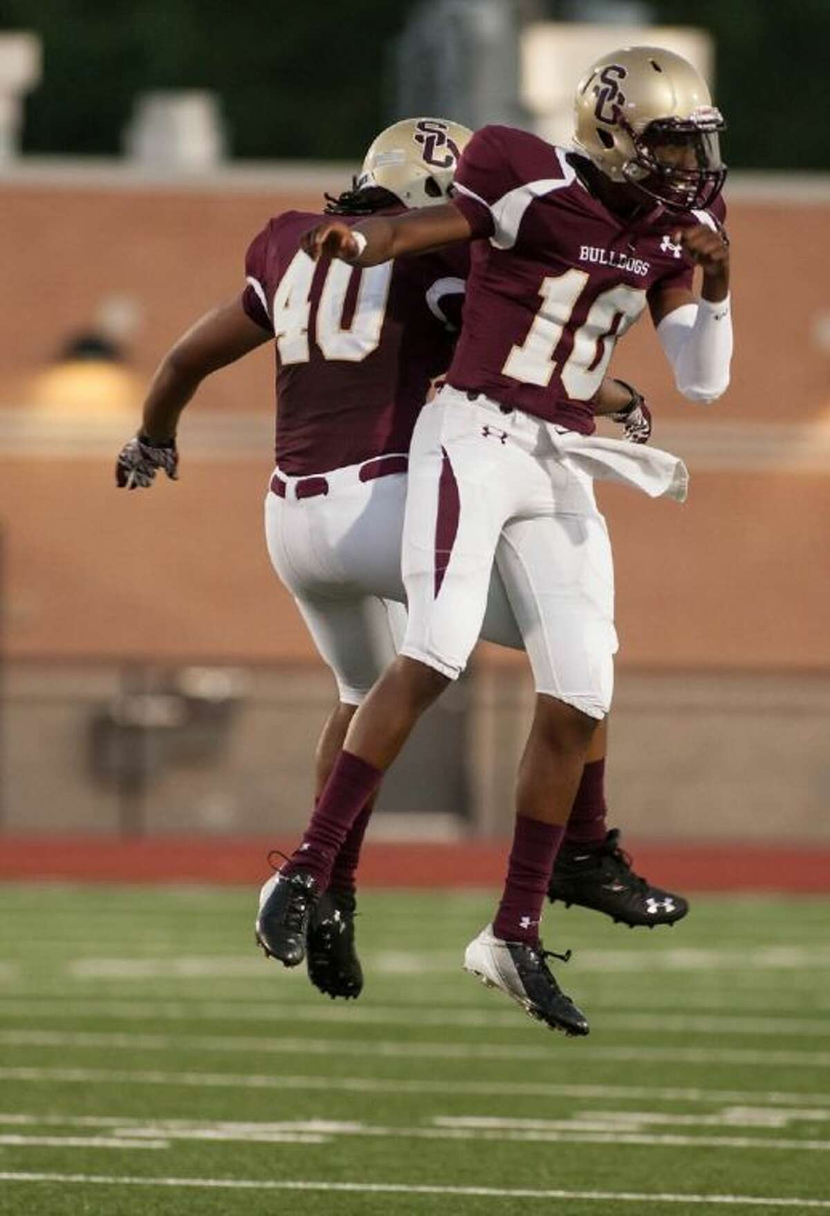 Dakota Allen (40) and Aaron Sharp (10) get pumped before their game against Port Neches Groves at Turner Stadium last Friday.