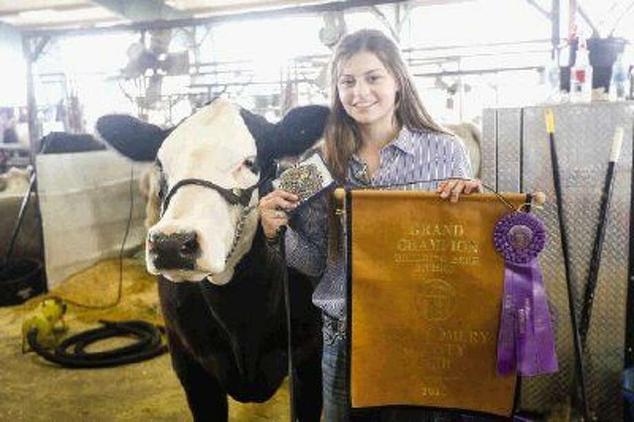 Kassi Koy, with Willis FFA, was named Grand Champion overall in the Breeding Beef division at the Montgomery County Fair this Sunday. Photo: Michael Minasi