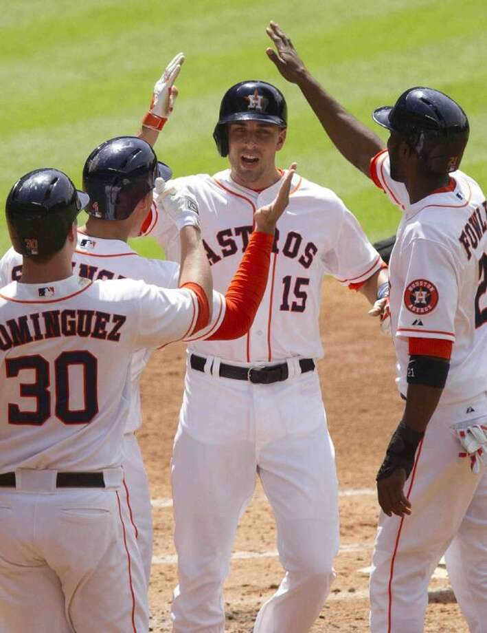 Jason Castro of the Houston Astros (15) celebrates a three-run home run with Matt Dominguez, George Springer and Dexter Fowler during a MLB baseball game Saturday. The Houston Astros defeated the Chicago White Sox 6-5. Go to HCNpics.com to view more photos from the game. Photo: Jason Fochtman