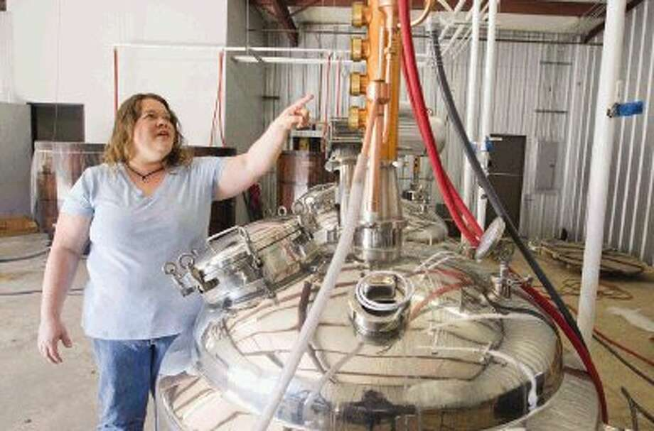 Gretchen Bass, with Big Thicket Distilling Company in Conroe, talks about the company's two small stills to make handcrafted vodkas and whiskies. Photo: Jason Fochtman / Conroe Courier / HCN
