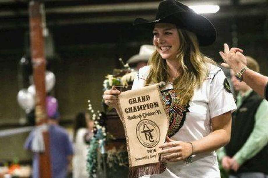 Carli Seiter, of Montgomery Dobbin 4-H, showcases her Handicraft Division II Grand Champion piece during the Montgomery County Fair Jr. Non-Livestock Auction on Monday. To view more photos from the auction, go to HCNPics.com.