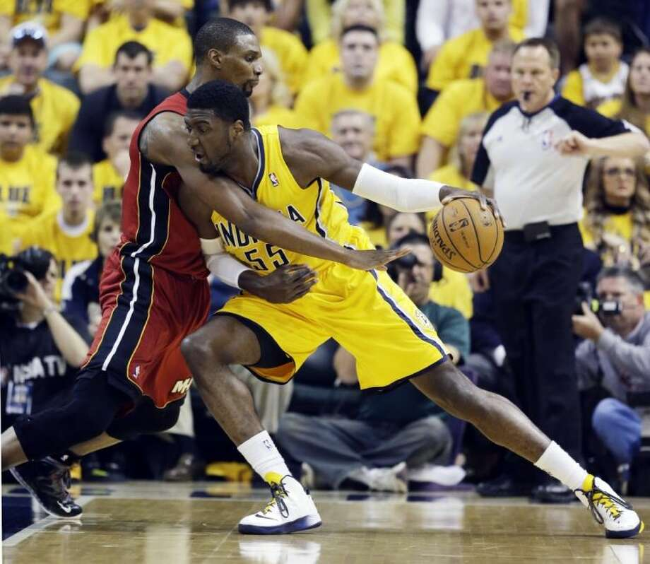 Indiana Pacers center Roy Hibbert, right, drives against Miami Heat center Chris Bosh. The Pacers won 107-96. Photo: Darron Cummings