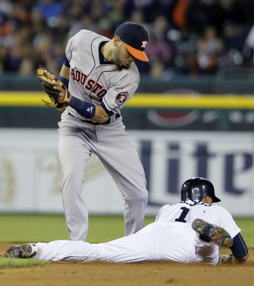 Detroit Tigers' Jose Iglesias beats the throw to Houston Astros shortstop Marwin Gonzalez to steal second base Friday in Detroit. Photo: Duane Burleson