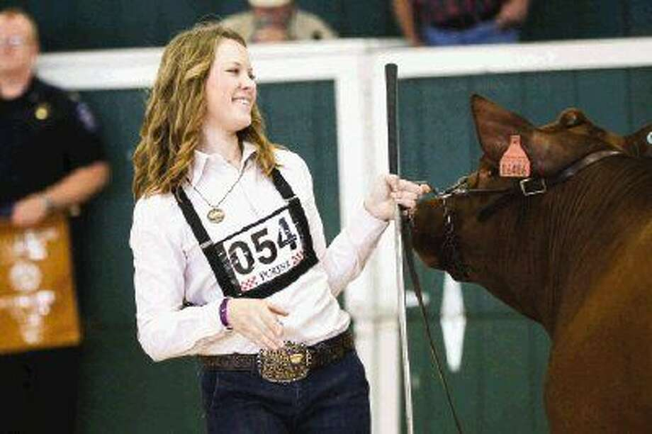 Montgomery High School junior and Montgomery County Fair Queen Bailey Carwile reacts after being named Grand Champion in the steer division on Tuesday at the Montgomery County Fairgrounds. Photo: Michael Minasi