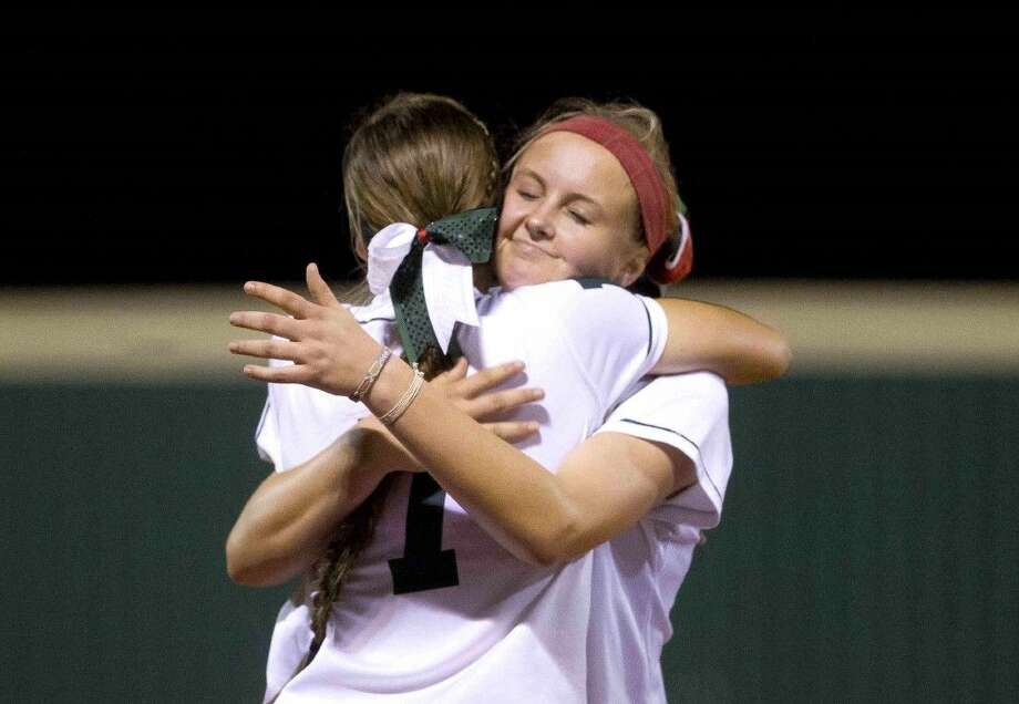 The Woodlands pitcher Emily Langkamp gets a hug from third baseman Caitlin Stavinoha in Mumford Friday. Photo: Jason Fochtman
