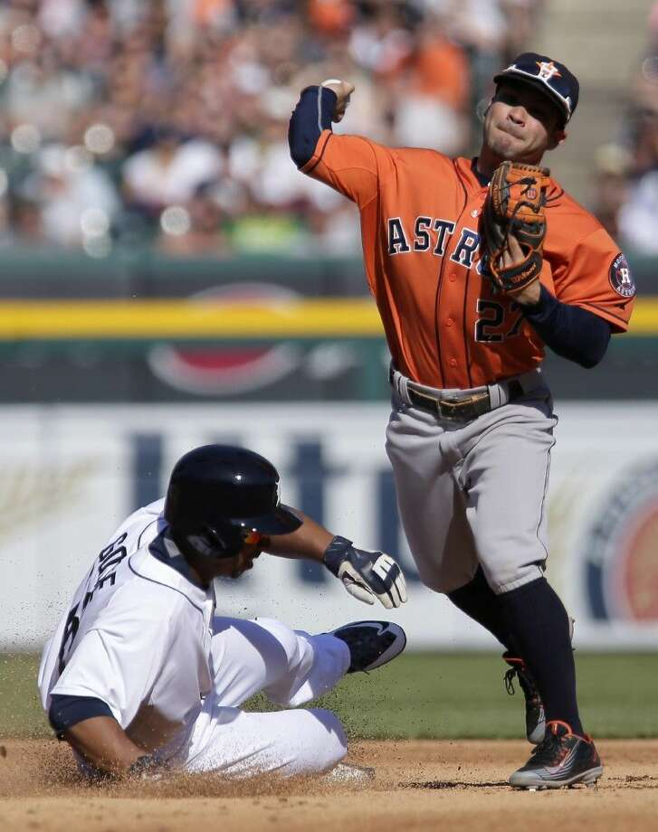 Astros second baseman Jose Altuve, right, gets the force on Detroit Tigers' Anthony Gose for the second out of a triple play. Photo: Duane Burleson