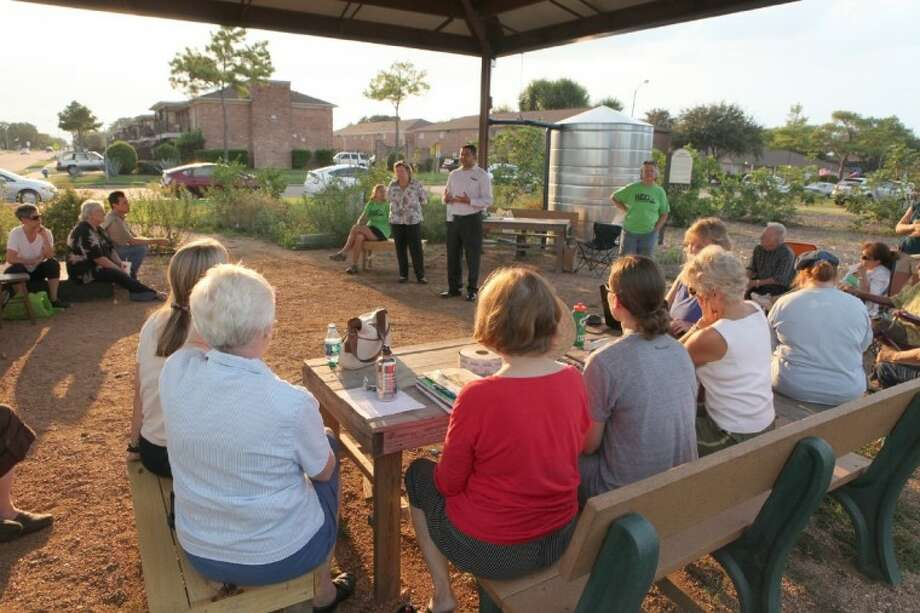 The Westbury Community Garden Club met last week to discuss property issues with Mark Cueva of the City of Houston. The city is considering using the land that the garden is on for more apartment housing. Photo: Photo By Alan Warren