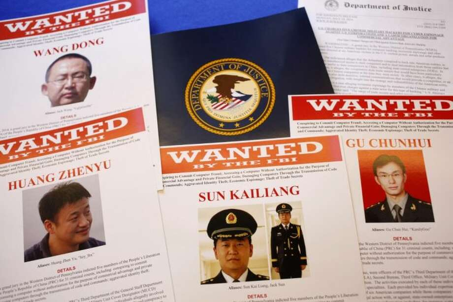 Press materials are displayed on a table of the Justice Department in Washington, Monday, May 19, 2014, before Attorney General Eric Holder was to speak at a news conference. Holder was announcing that a U.S. grand jury has charged five Chinese hackers with economic espionage and trade secret theft, the first-of-its-kind criminal charges against Chinese military officials in an international cyber-espionage case. Photo: Charles Dharapak
