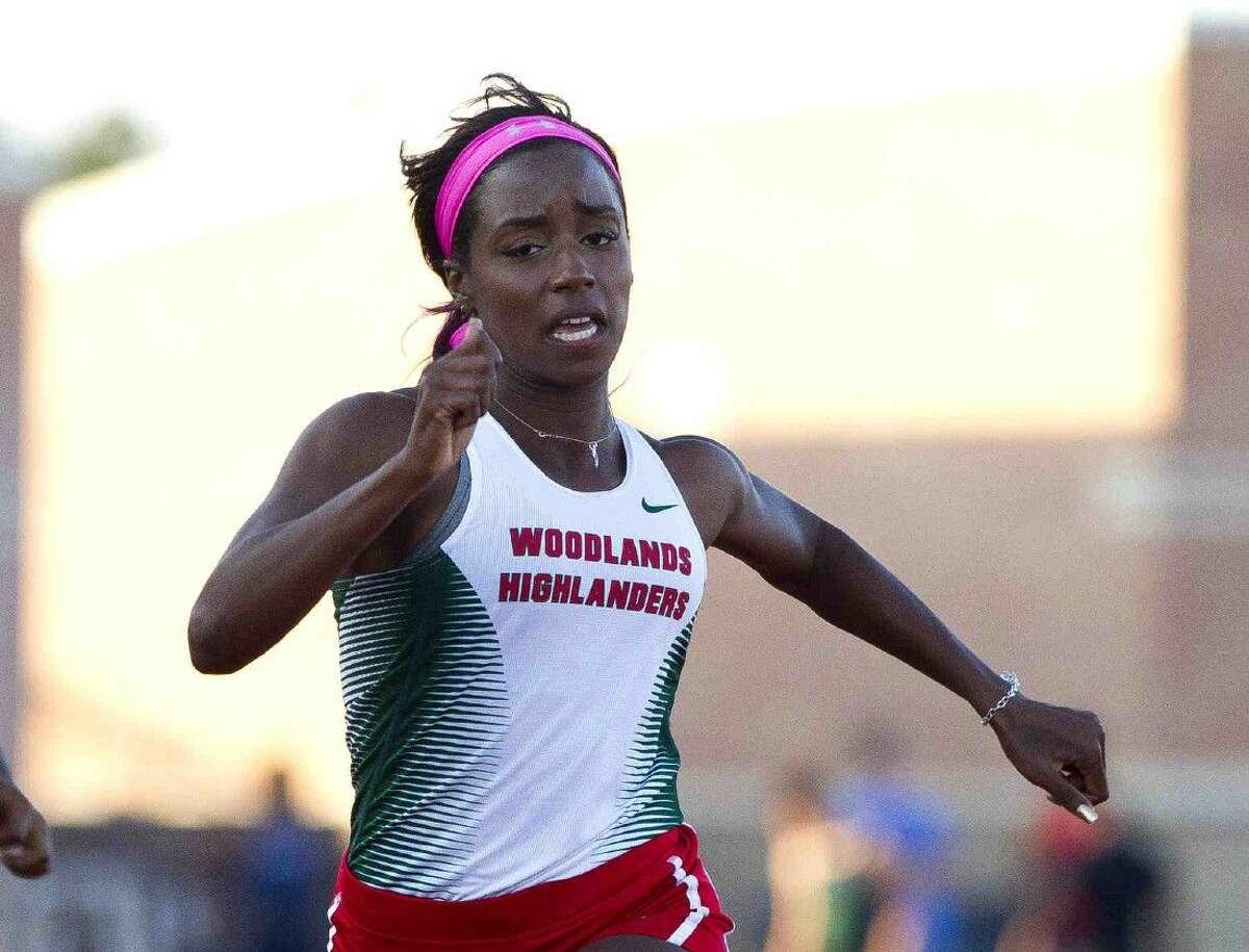 The Woodlands' Charity Thomas competes in the girls 100-meter dash during the District 16-6A track and field championships on Thursday in Humble.
