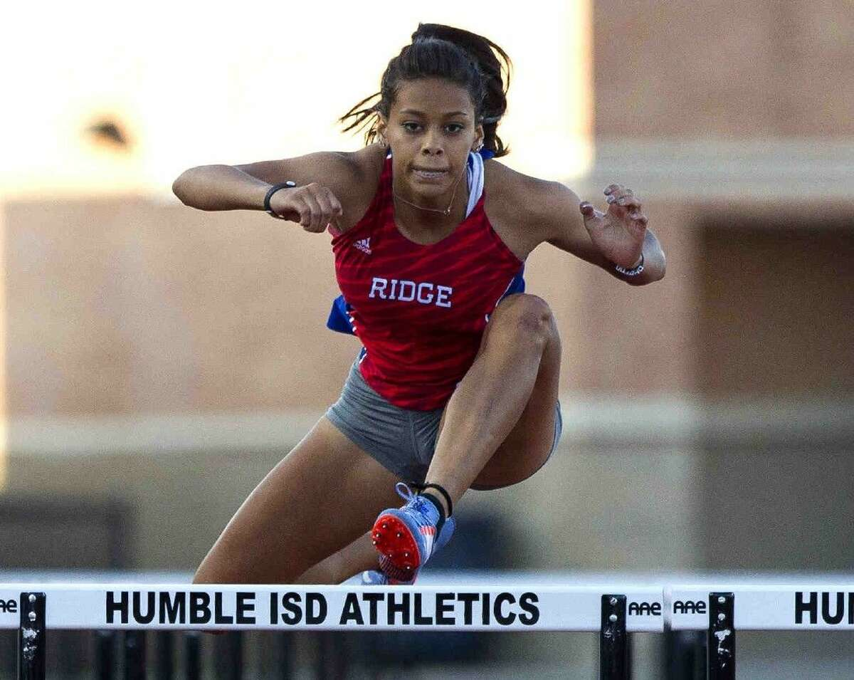 Oak Ridge's Baylee Lara competes in the girls 100-meter hurdles during the District 16-6A track and field championships on Thursday in Humble.