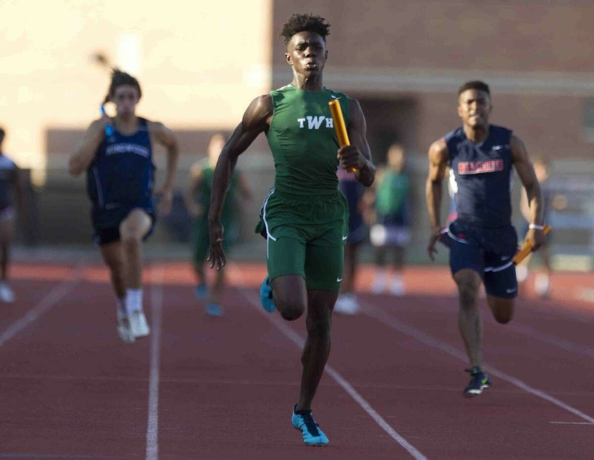 The Woodlands' Kesean Cater competes in the boys 4x100-meter relay during the District 16-6A track and field championships on Thursday in Humble.