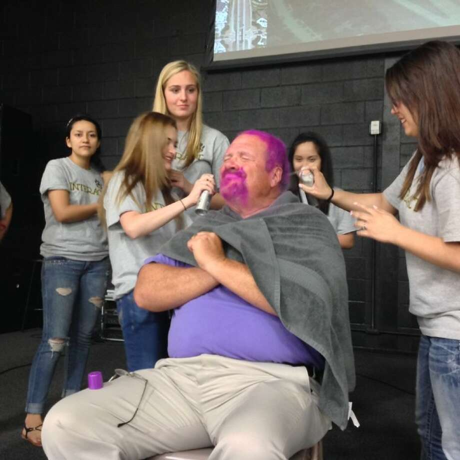 Ron Saikowski, Conroe Interact Club adviser, received purple hair and beard after successfully challenging the club to to contribute $1,000 to Rotary International's Polio Eradication Campaign.