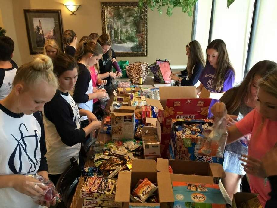 Members of the Montgomery High School National Charity League make snack and toiletry bags for veterans at the VA hospital.