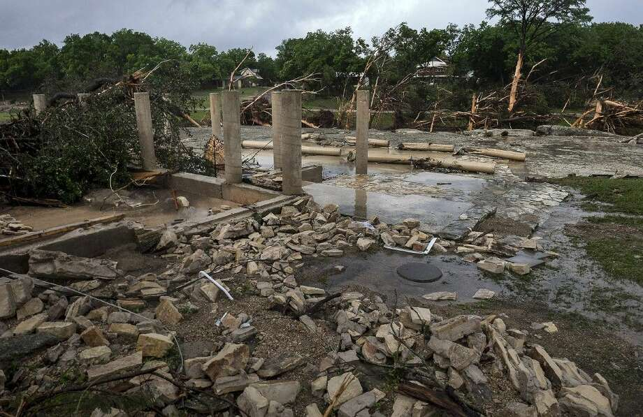 The cement stilts of the home belonging to the Carey family of Corpus Christi are all that remain the home was swept away by the Blanco River early Sunday morning during a flash flood in Wimberley. Photo: Rodolfo Gonzalez