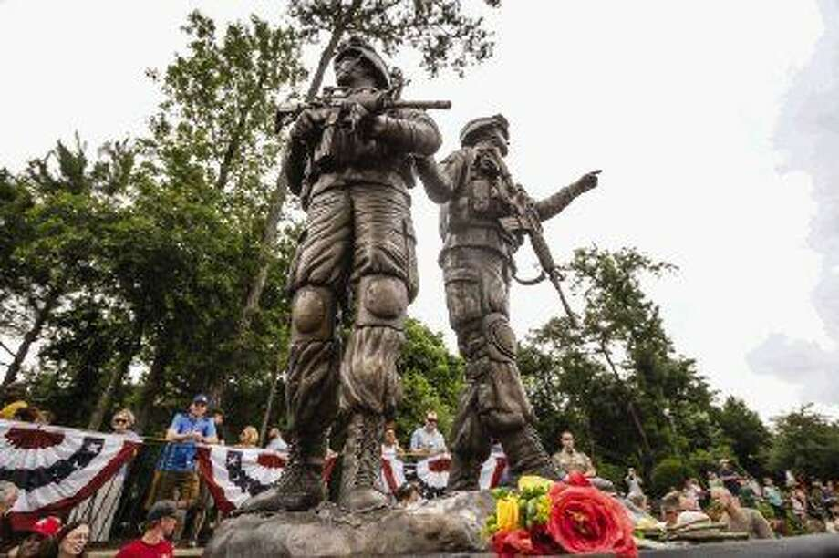 The Way Home Veterans Memorial was unveiled on Monday at Town Green Park. It is meant to remember not only veterans still alive and those who have died, but also Army Cpl. Cory Kosters and Cpl. Zachary Endsley who both died while serving in the Middle East in 2007. Photo: Michael Minasi