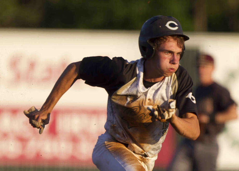 Dawson Shibley, of Conroe, scores a run off a Summer Creek error in the first inning of a District 16-6A baseball game Friday. Go to HCNpics.com to purchase this photo and others like it. Photo: Jason Fochtman