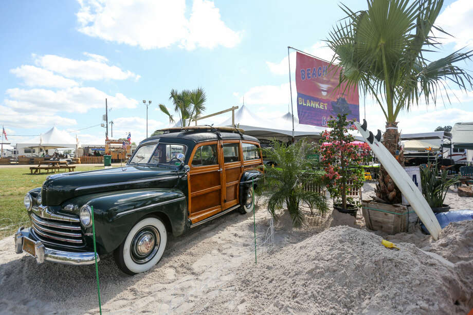 The Beach Blanket Barbecue team's cook site featured three dump trucks full of sand, palm trees, a lifeguard stand, a vintage donated car from the Concours d'Elegance of Texas car show, and much more for the 2016 Bud Light BBQ Cook-Off on Friday at the Montgomery County Fairgrounds. Photo: Michael Minasi