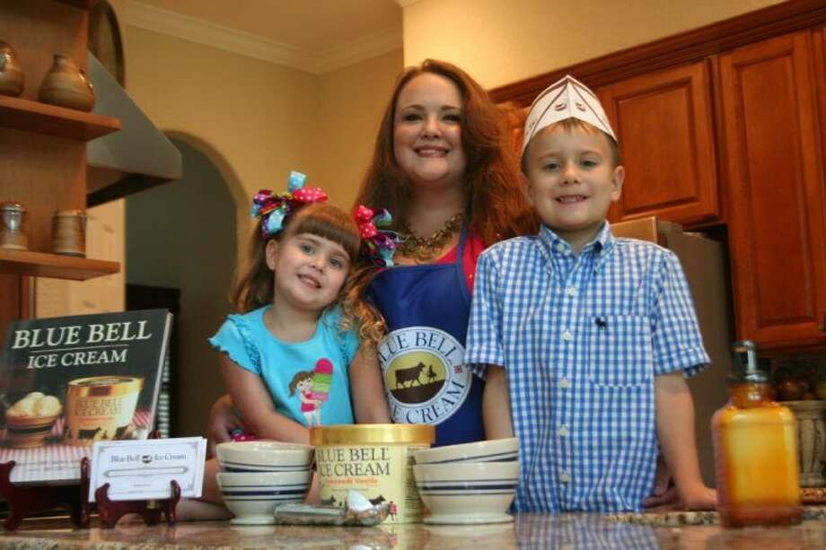 """Heather Brown and her two children received 52 gift certificates for Blue Bell Ice Cream, a coffee table book, an apron, hats and a scooper when Brown was announced as a finalist in Blue Bell's """"Do Tell"""" contest. Photo: Nate Brown"""