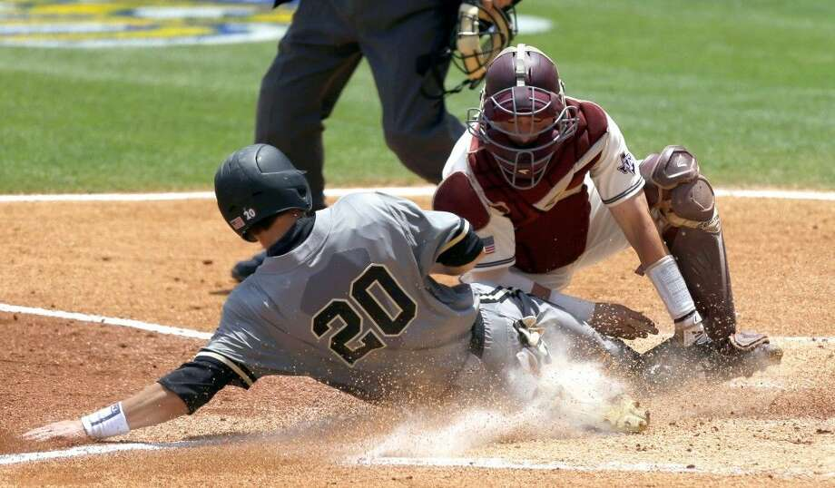 Texas A&M catcher Michael Barash, right, and the Aggies open NCAA tournament play on Friday against Texas Southern. Photo: Butch Dill