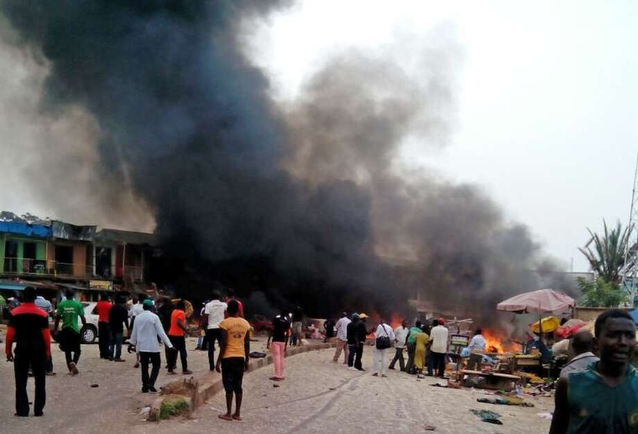 Smoke rises after a bomb blast at a bus terminal in Jos, Nigeria Tuesday..